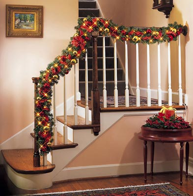 Christmas decor ideas southern style re max realty west for Stair railing decorated for christmas