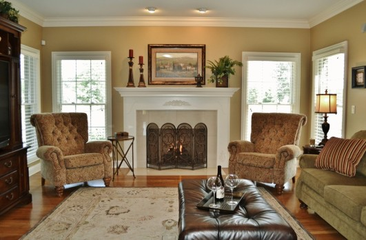 chic-small-recliners-technique-chicago-traditional-family-room-inspiration-with-armchair-art-above-fireplace-crown-molding-family-friendly-family-room-fireplace-ottoman-sofa-sophisticated